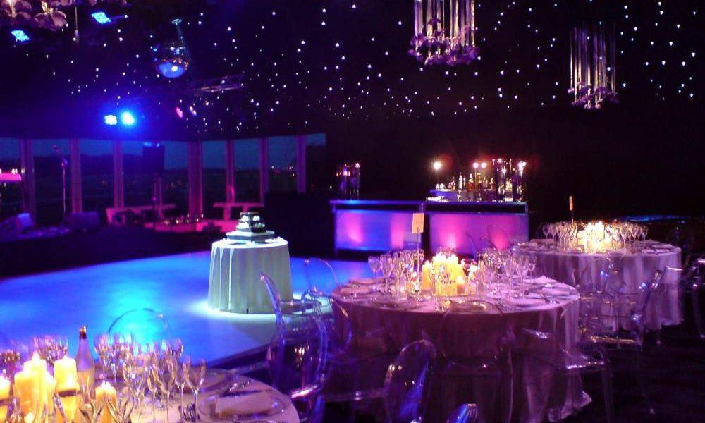 Dancefloor - Wedding cake on lit white dancefloor with 'ghost' chairs