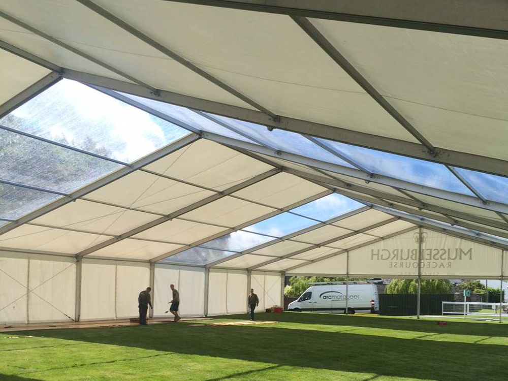Industrial Hire - Occasional clear roofs in unfloored marquee